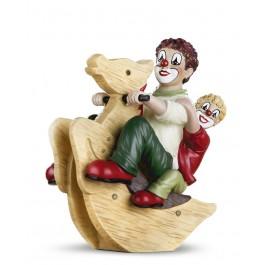 Clowns sur cheval à bascule